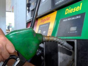 Hand holding diesel gas pump