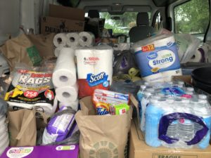 Vanload of cleaning supplies and food